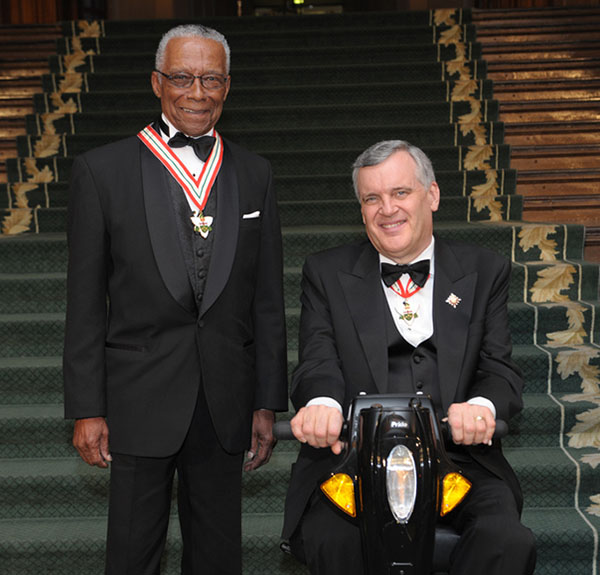 Dr. Howard McCurdy, left, poses with Lieutenant Governor of Ontario, David C. Onley, who presented him with the Order of Ontario on January 26, 2012.