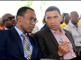 Jamaica's new Finance Minister, Dr. Nigel Clarke (left) and Prime Minister, Andrew Holness.