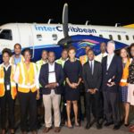 St. Lucia Tourism Minister, Dominic Fedee (seventh from right, in navy blue suit and tie) with officials of the new airline.
