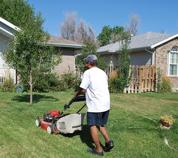 Man mowing lawn 1