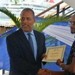Port Authority of Jamaica President and Chief Executive Officer, Professor Gordon Shirley (left), presents a certificate to fisherman and business operator, Richard Morris, who participated in the Tourism Product Development Company's recent training program for stakeholders, who will operate in the new state-of-the-art fishing village being developed in Ocho Rios, St. Ann. Photo credit: Garwin Davis/JIS.