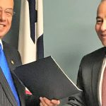 Antigua and Barbuda's Ambassador in the United States, Sir Ronald Sanders (left), receives the donation from Panama's Ambassador to Antigua and Barbuda, Jesus Sierra Victoria.