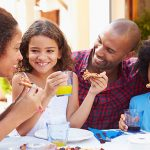 Family Eating Meal At Outdoor Restaurant Together; Shutterstock ID 238064596; Bon de commande: -