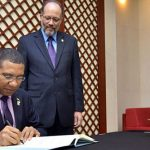 Jamaican Prime Minister Signs CARICOM Agreements