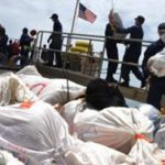 The crew of the Coast Guard Cutter Thetis offloads approximately 2,116 pounds of marijuana after returning to homeport in Key West, Florida, Friday, June 8, 2018. In March, Thetis crewmembers alongside an MH-65 Dolphin helicopter crew from Air Station Borinquen, Puerto Rico, and a Jamaican Defence Force crew interdicted a suspected drug smuggling vessel in the Caribbean. (U.S. Coast Guard photo by Petty Officer 2nd Class Ashley J. Johnson)
