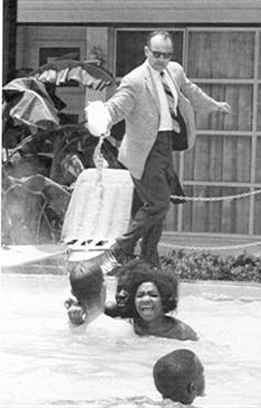 June 1964. Black children integrate the swimming pool of the Monson Motel in St. Augustine, Fla. To force them out, the manager of the motel pours acid into the water. Horace Cort.