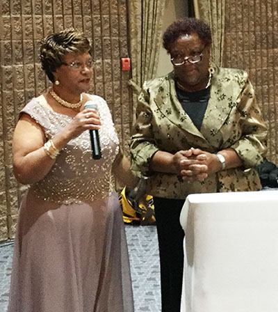 Sharmon Carrington (left), President of CHAAG-Toronto, introduces the keynote speaker for the reunion's gala, Yvonne Sam.