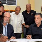 State Minister in the Culture, Gender, Entertainment and Sport Ministry, Alando Terrelonge (left), co-signs the Memorandum of Understanding between the G.C. Foster College of Physical Education and Sport, and Sprintec Track Club, during a ceremony at the College's Campus in Angels, St. Catherine, last Friday. Others looking on (from 2nd left) are: College Chairman, David Mais; President, Jamaica Athletic Administrative Association, (JAAA), Dr. Warren Blake; Acting College Principal, Maurice Wilson; Sprintec Chairman, Dr. Paul Auden; and Jamaica Olympic Association (JOA) President, Christopher Samuda. Photo credit: Dave Reid.