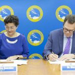 ITC Executive Director, Arancha González (left) and CDB President, Dr. William Warren Smith (right) sign the partnership agreement at CDB's headquarters in Barbados.