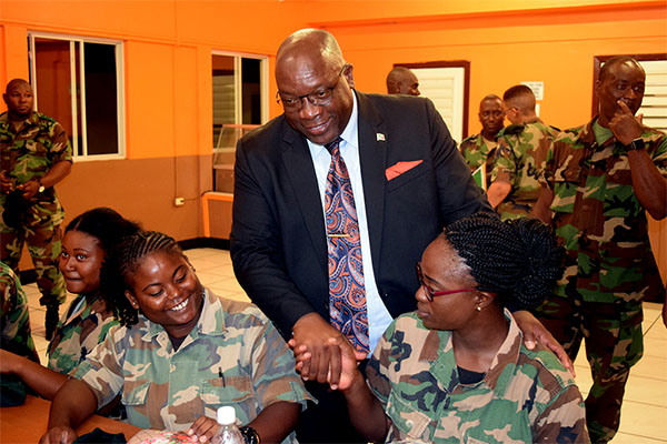 Prime Minister Harris interacts with SKNDF reserves.