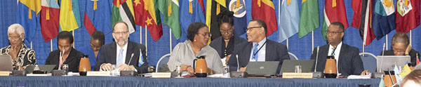Chair of the Meeting, Prime Minister, Mia Mottley, of Barbados (4th left), CARICOM Secretary-General, Ambassador Irwin LaRocque (3rd left) and CARICOM Secretariat officials at the Head Table.