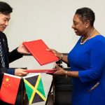 Minister of Culture, Gender, Entertainment and Sport, Olivia Grange (right), completes signing major sport cooperation agreement with the General Manager of the state-owned China Sport International Company, Lu Guoguang (left). Under the agreement, more than 400 athletes from Jamaica will receive high-level training at specialised centres in China, over the next three years. Photo credit: JIS.