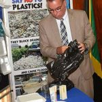 Minister without Portfolio in the Ministry of Economic Growth and Job Creation, Daryl Vaz, looks at some of the plastic products that the government will ban starting January 2019. The Minister announced a ban on the importation, manufacturing, distribution and use of specific categories of plastics during a press conference at Jamaica House, on Monday (September 17). These items include single-use plastic carrier/shopping bags; expanded polystyrene foam, commonly referred to as styrofoam; and plastic drinking straws. Photo credit: Rudranath Fraser/JIS.