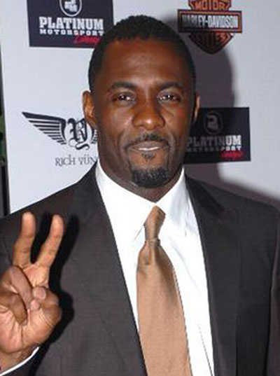 Idris Elba at the American Music Awards, in 2007. Photo by Idris_Elba.jpg: lukeford.net http://www.lukeford.net/Images/photos/11-19-2007/DSC_0004.JPG : 1 2derivative work: Darkwarriorblake - This file was derived from: Idris Elba.jpg:, CC BY-SA 2.5, https://commons.wikimedia.org/w/index.php?curid=20471823.