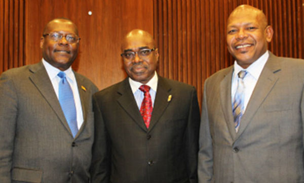 The late Leonard Wharwood Jr. (right) seen with Deputy Honourary Consul in Montreal, Theodore Blaize (left), and Consul General for Toronto, Derrick James. Photo by Junior Baptiste.