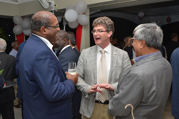 British High Commissioner, Gregory Quinn (centre), share a laugh with one of the Directors of Guyana Oil and Gas Association (GOGA) and another guest at the networking reception, hosted by the Canadian High Commissioner.