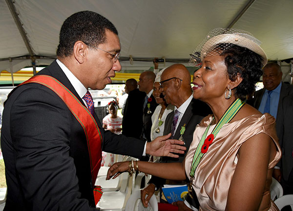 Prime Minister, Andrew Holness, greets United States Congresswoman, Yvette D. Clarke, after she received her Order of Distinction, Officer Class, honour.