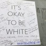 It's Okay To Be White poster photographed on the University of Toronto campus. Photo credit: Tom Yun/The Varsity.