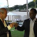 Egyptian telecom tycoon, Naguib Sawiris, (left) and Grenada Prime Minister, Dr. Keith Mitchell, toast the opening of the new hotel. Photo credit: CMC.