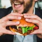A new study finds more Canadians are considering giving up meat, but men are less likely to quit their carnivorous ways. Photo credit: Sander Dalhuise/Unsplash.