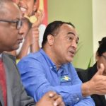 Jamaica's Minister of Health, Dr. Christopher Tufton (centre), responds to a question during a press conference held at the Ministry's New Kingston offices ,on Wednesday (December 12). He is flanked by Permanent Secretary, Dunstan Bryan; and Chief Medical Officer, Dr. Jacqueline Bisasor-McKenzie. Photo credit: Donald De La Haye/JIS.