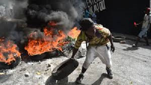 Protestors burn tires in the streets in Haiti. Photo credit: Caribbean Media Corp.