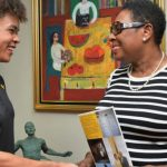 Olivia Grange, Minister of Culture, Gender Entertainment and Sport (right) greets Lydia Heywood, the England-born Eventing rider, who plans to represent Jamaica at the next Olympics. Photo contributed.
