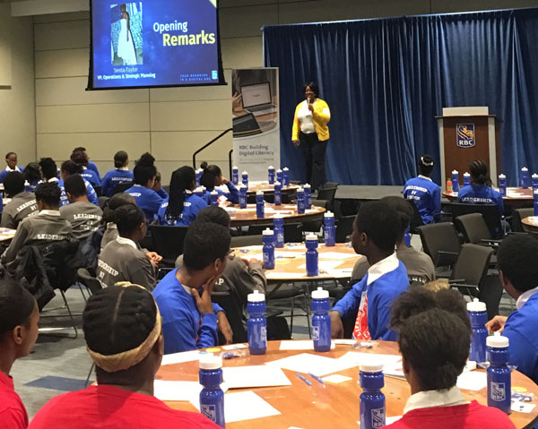 Senta Taylor, Vice-president, Operations and Strategic Planning, RBC, who sponsored the event, welcomes the students, their parents and volunteers to the hackathon on Saturday, December 1, 2018.