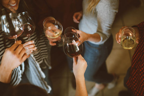Interspersing alcohol with non-alcoholic drinks can be a strategy to avoid overconsumption. Photo credit: Kelsey Chance/Unsplash.