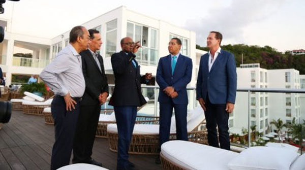 Prime Minister, Andrew Holness (second right), listens attentively to Tourism Minister, Edmund Bartlett (centre), at the official opening of the 120-room S Hotel in Montego Bay, St. James, on January 27. Also listening (from left) are: Minister of National Security, Dr. Horace Chang; Mayor of Montego Bay, Councillor Homer Davis; and the hotel's owner, Businessman and Developer, Christopher Issa. Photo Credit: Garwin Davis/JIS.
