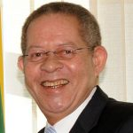 Former Jamaica Prime Minister, Bruce Golding, commented on the no confidence motion matter in Guyana in an op-ed in the Jamaica Observer newspaper. Photo by Antônio Cruz/ABr - http://agenciabrasil.ebc.com.br/ultimasfotos?p_p_id=galeria&p_p_lifecycle=0&p_p_state=normal&p_p_mode=view&p_p_col_id=column-1&p_p_col_count=1&_galeria_railsRoute=%2Fgerenciador_galeria%2Fgaleria%2Fshow%3Fid%3D520#http://agenciabrasil.ebc.com.br/galeriaimagens/images/fotos/3905/normal?p_p_id=galeria, CC BY 3.0 br, https://commons.wikimedia.org/w/index.php?curid=10183425