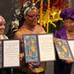 From right to left:  Ellen Johnson Sirleaf, Leymah Gbowee and Tawakkul Karman  display their awards during the presentation of the Nobel Peace Prize, on December 10, 2011. Johnson Sirleaf entered the history books when she became the Liberian President and the first democratically-elected female president on the African continent. She was Liberia's 24th president and has successfully won two terms in office. Sirleaf. Photo by Harry Wad, CC BY-SA 3.0, https://commons.wikimedia.org/w/index.php?curid=17644059.