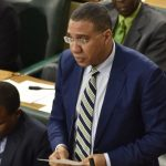 Jamaican Prime Minister, Andrew Holness, addresses yesterday's (February 12) sitting of the House of Representatives. To his right is Minister of Finance and the Public of Service, Dr. Nigel Clarke. Photo credit: Donald De La Haye.
