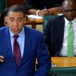 Prime Minister, Andrew Holness, addresses the House of Representatives, yesterday. At right is Minister of State in the Office of the Prime Minister with responsibility for Works, Everald Warmington. Photo credit: Mark Bell/JIS.
