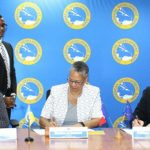 Caribbean Development Bank Vice-President, Monica La Bennett (centre), and AFD Atlantic Regional Director, Philippe La Cognata (right), sign the agreement. Photo courtesy of the CDB.