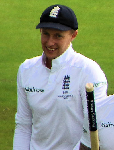 Joe Root at The Ashes -- a Test cricket series, played between England and Australia -- in 2015. Photo by Airwolfhound - https://www.flickr.com/photos/24874528@N04/20417951192/, CC BY-SA 2.0, https://commons.wikimedia.org/w/index.php?curid=66047166.