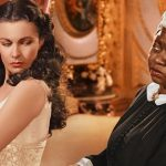 The historical depiction of 'the mammy' is a racist stereotype, with an enduring impact. Hattie McDaniel (right) won an Oscar for her role in 'Gone with the Wind' with Vivien Leigh (left). Photo credit: Selznick International Pictures.