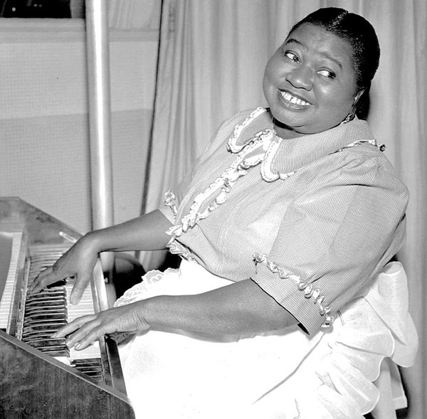 Hattie McDaniel received the Academy Award for the best performance in a supporting role, in 1939, for her work as 'Mammy' in 'Gone With the Wind.' In photo, McDaniel is seen as as Beulah, from the radio program of the same name. The original role was voiced by actor en:Marlin Hurt. Shortly after his sudden death in 1946, the role went to African-American actresses, beginning with Hattie McDaniel. Photo by CBS Radio - eBayfrontback, Public Domain, https://commons.wikimedia.org/w/index.php?curid=33363819.