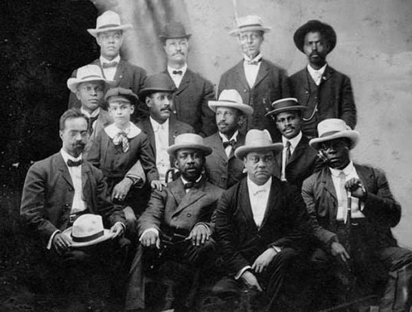 A closer look at the studio photo taken at the Niagara Movement meeting in Fort Erie Canada, 1905. Top row (left to right): H. A. Thompson, Alonzo F. Herndon, John Hope, James R. L. Diggs (?). Second row (left to right): Frederick McGhee, Norris B. Herndon (boy), J. Max Barber, W. E. B. Du Bois, Robert Bonner. Bottom row (left to right): Henry L. Bailey, Clement G. Morgan, W. H. H. Hart, B. S. Smith. Photo credit: Library of Congress, CC BY.