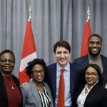 Canadian Prime Minister, Justin Trudeau (fourth from left) and Immigration Minister Ahmed Hussen (right) met with Board Members of the Operation Black Vote Canada, from left to right: Ian Allen, Vice-Chair; Marva Wisdom, Director at Large; Wendy Vincent, Director of Communications; Velma Morgan, Chair; Joseph Smith, Director of Youth Outreach; and Nicole Miller, Director of Outreach and Events. Photo contributed.