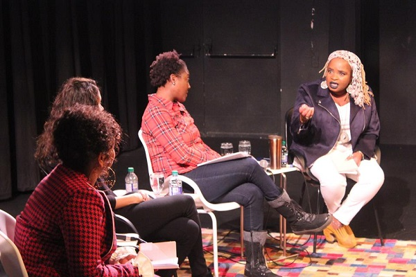 "At last year's Kuumba's Journey to Black Liberation Symposium, ""Womanism, Black Feminism and the Politics of Love"", Dr. Dryden (right) passionately makes a point to the other panelists: Dr. Erica Lawson, El Jones and Rania El Mugammar. Photo by Brandon Hay."
