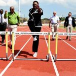 Minister of Culture, Gender, Entertainment and Sport, Olivia Grange (centre), attempts to clear a hurdle at the new East Track at the National Stadium in St. Andrew on Monday (March 25). Others (from left) are Permanent Secretary in the Ministry, Denzil Thorpe; General Manager at Independence Park Limited (IPL), Major Desmon Brown; Chairman of IPL, Mike Fennell, and Deputy Chairman, David Shirley. The occasion was the official opening of the new track, which was developed at a cost of $71.5 million. Photo credit: Michael Sloley/JIS.
