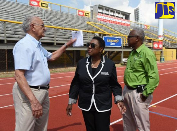 Sport Minister Grange (centre), is in discussion with Chairman of Independence Park Limited (IPL), Mike Fennell (left), at the official opening of the new $71.5-million East Track at the National Stadium in St. Andrew, on March 25. At right is General Manager at IPL, Major Desmon Brown.