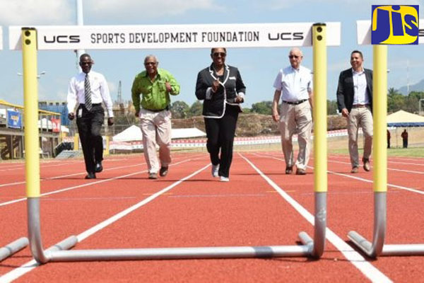 Minister Grange, (third left), tries out the new $71.5-million East Track at the National Stadium in St. Andrew, which was officially opened on Monday. Others (from left) are Permanent Secretary in the Ministry, Denzil Thorpe; General Manager of Independence Park Limited (IPL), Major Desmon Brown; Chairman of IPL, Mike Fennell; and Deputy Chairman, David Shirley.
