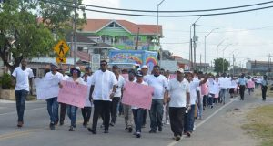 "Guyana Opposition Supporters March Demanding Removal Of ""Illegitimate"" Government"