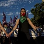 Activists take part in a march on the eve of the commemoration of the International Day for the Elimination of Violence Against Women, in Santiago. Photo credit: Crisis Group.