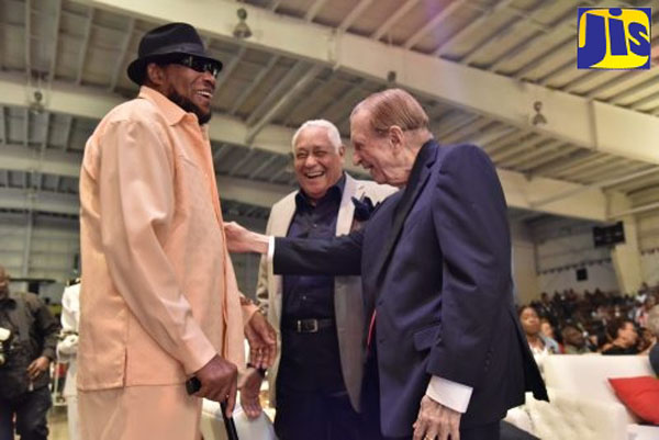 Former Prime Minister, Edward Seaga (right) and Minister without Portfolio in the Office of the Prime Minister, Mike Henry (centre), enjoy a light moment with Ska icon, Derrick Morgan, at the Reggae Gold Awards Ceremony, held on February. The event climaxed Reggae Month celebrations. Photo credit: Donald De La Haye/JIS.