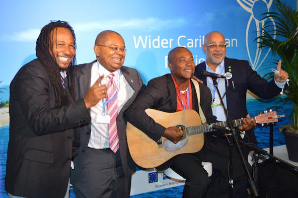 Dr. James Fletcher (second from left), Jamaican artistes and the Director General of the OECS Commission, Dr. Didacus Jules (far right), celebrate the success of the 1.5 to Stay Alive Campaign, during the Paris Climate Talks. Photo courtesy of Dr. James Fletcher.