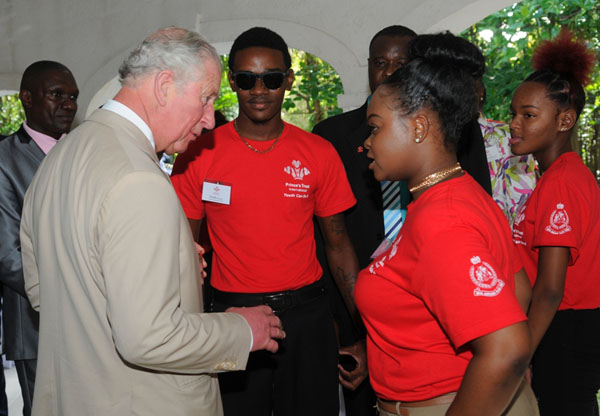 The Prince of Wales seen chatting with some of the participants of the Prince's International Trust during a reception on Tuesday, March 19.