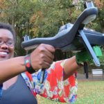 Tanzanian ICT entrepreneur, Rose Funja, shows off one of the drones she uses as a key tool in her data mapping business. Photo credit: Busani Bafana/IPS.